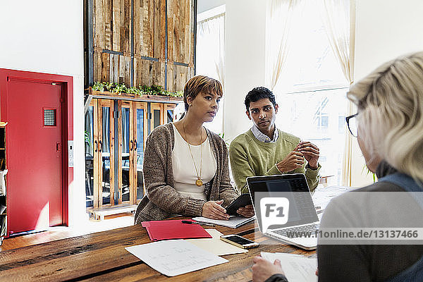 Business colleagues during meeting at conference table in office