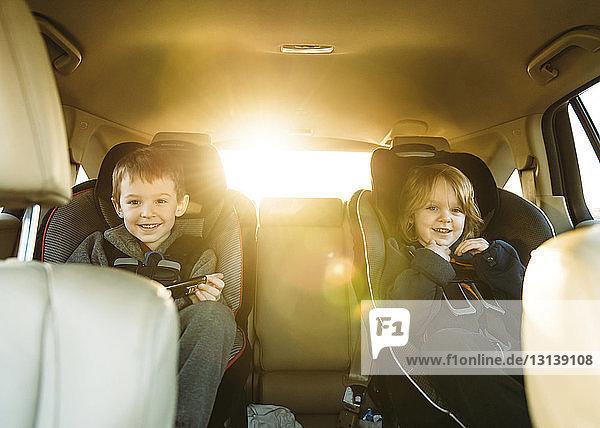 Portrait of boys sitting in car