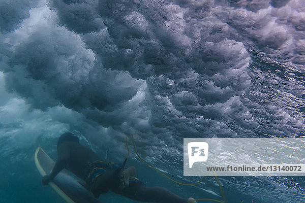 Low angle view of man surfing undersea