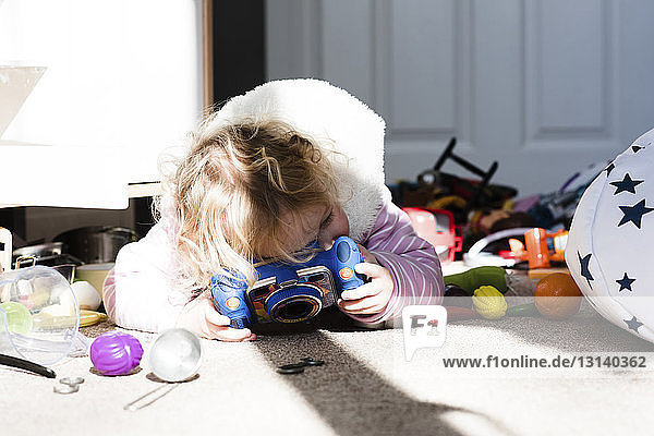 Girl playing with toys on rug at home