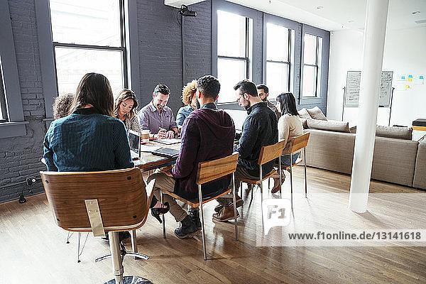Business people planning at table in office