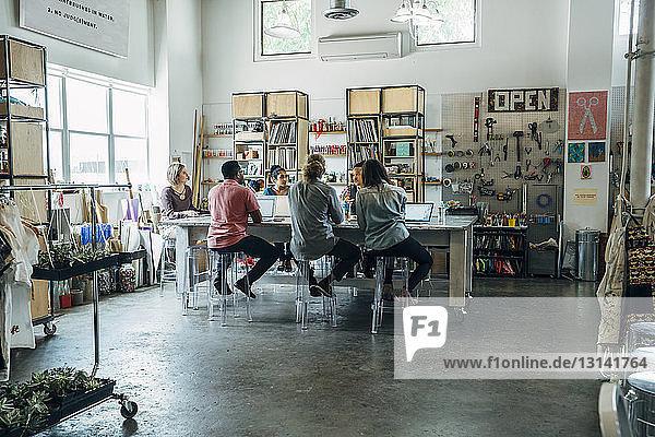 Business people having meeting in creative office