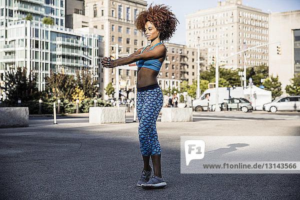 Woman exercising on city street