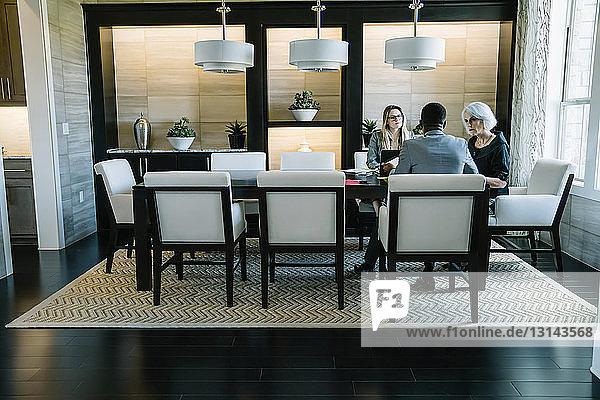 Business people working in board room at office