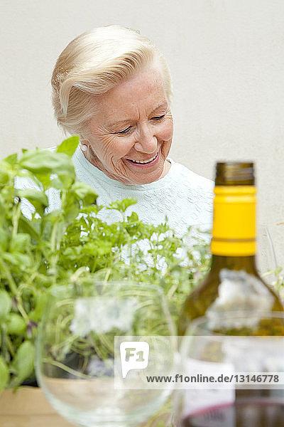 Senior woman sitting at garden table