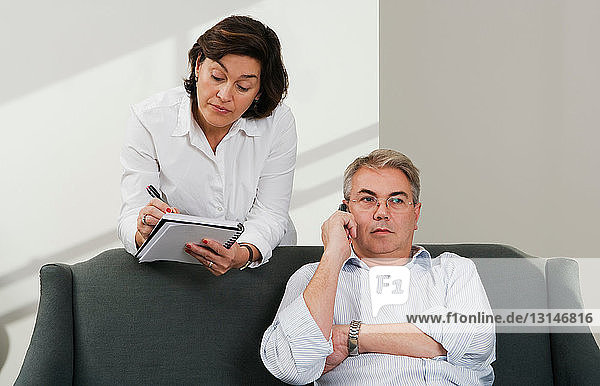 Mature couple working from home