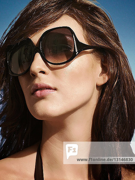 Close up of woman wearing sunglasses
