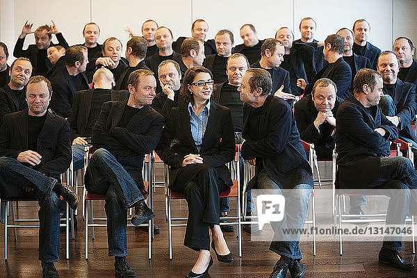 businesswoman surrounded by man 25 times businesswoman surrounded by man 25 times
