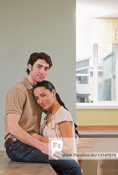 couple talking in kitchen