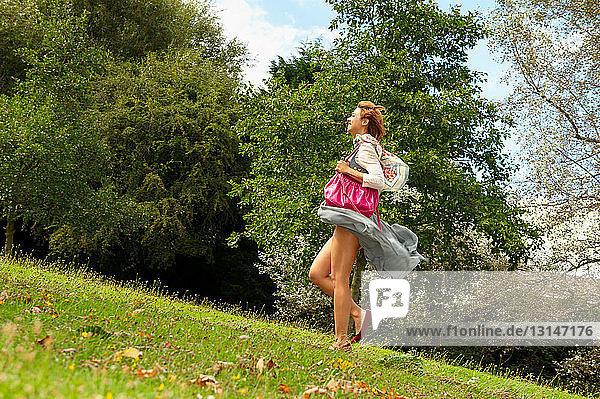 Woman walking in wind