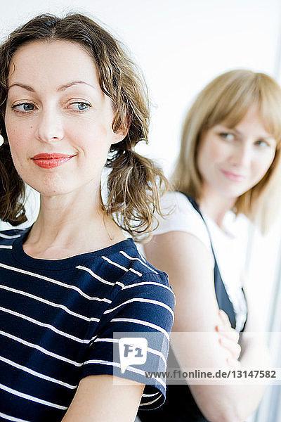 2 businesswomen thinking