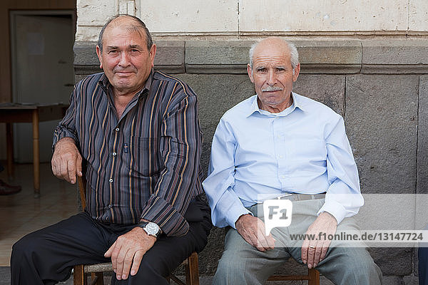 two old men sitting outside