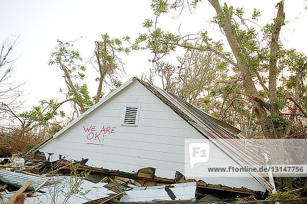 Upper level of residential house on ground amidst wreckage  aftermath of Hurraine Katrina  Biloxi  USA