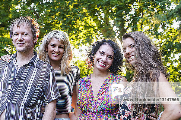 Portrait of four adult friends at party in garden