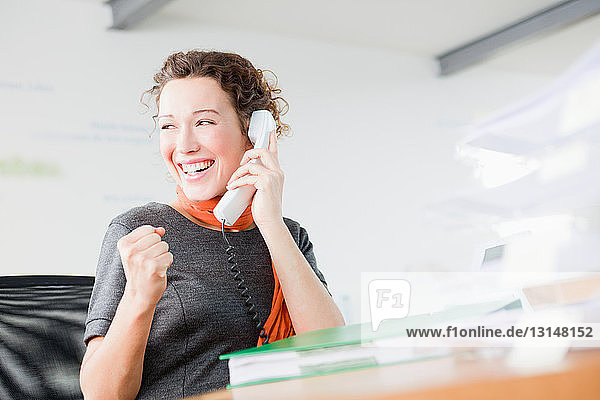 Woman enjoying herself on the phone