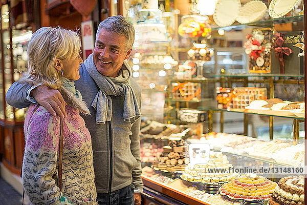 Romantic mature couple at cake shop window  Majorca  Spain