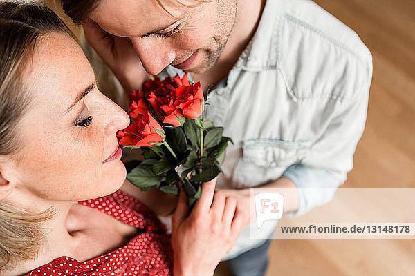 Man giving woman roses  high angle