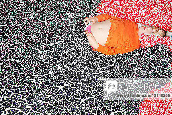 Girl sleeping in patterned sheets