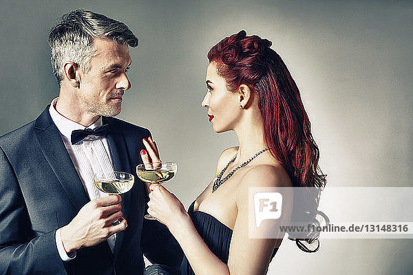 Portrait of couple celebrating with toast