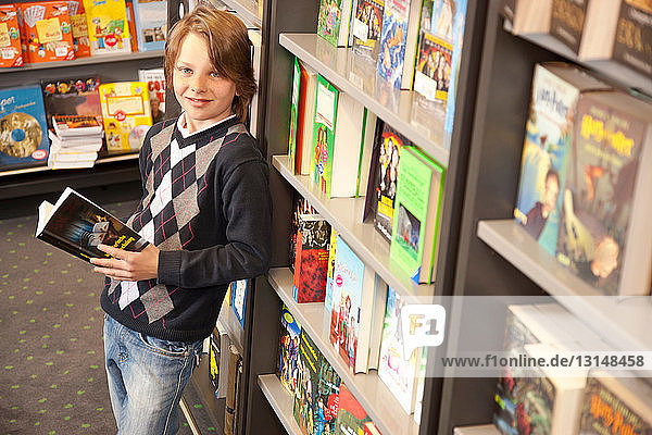 Boy browsing books in the book store