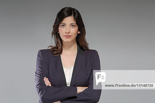 Portrait of young businesswoman  arms folded