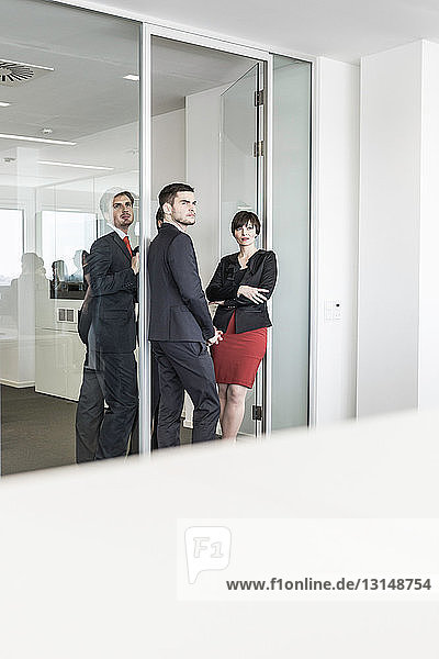 Businesspeople standing in doorway