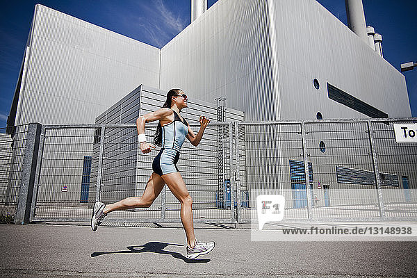 Woman running in city