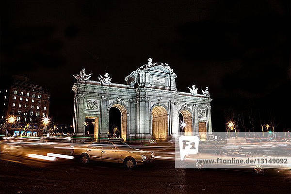 Puerta de Alcala lit up at night