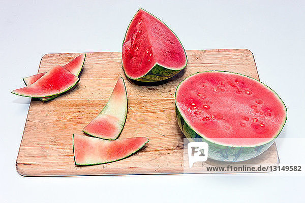 Slices of ripe watermelon on cutting board