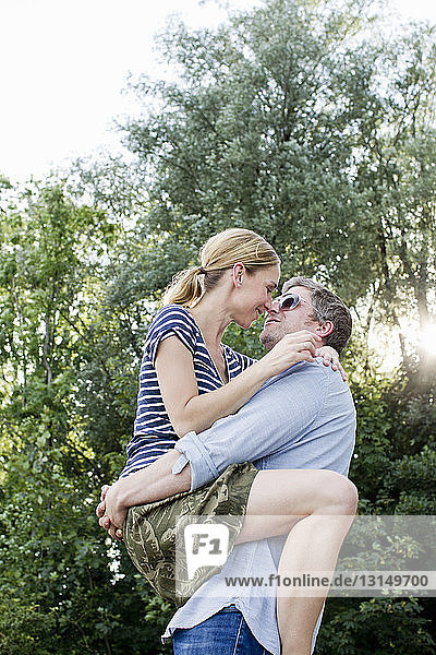 Couple in loving embrace outdoors