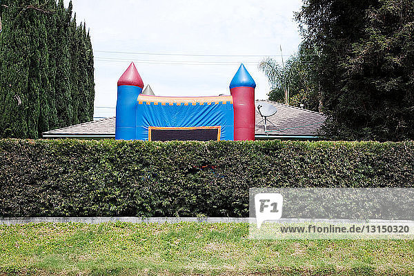 Inflatable bouncy castle on suburban street