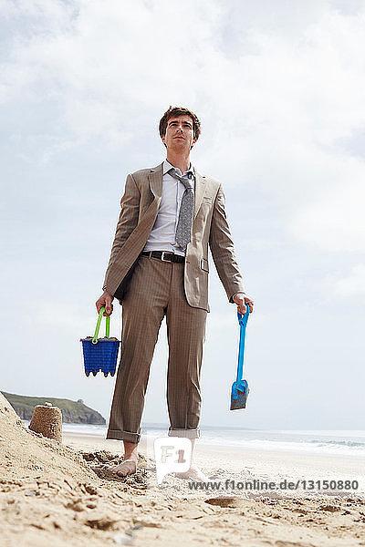 Businessman building sand castle