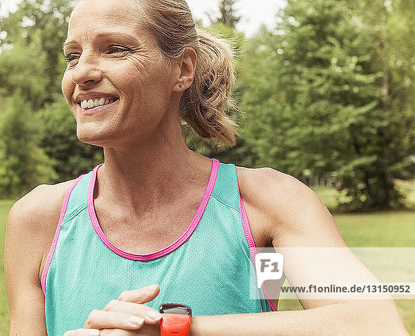 Mature woman  working out  outdoors  smiling