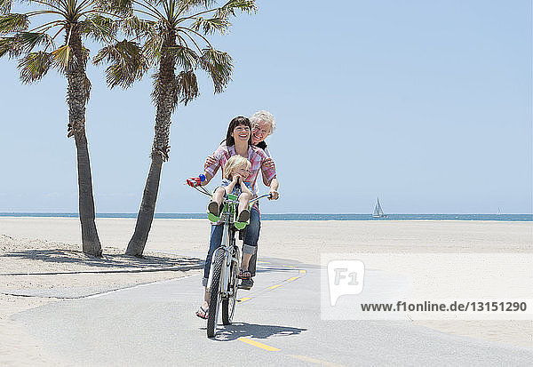 Mother  daughter and grandson on one bicycle  Venice Beach  California  USA