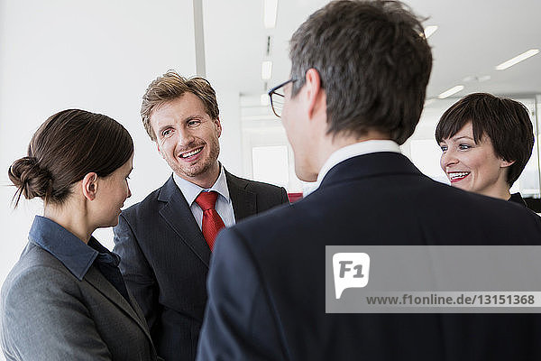 Four businesspeople having conversation