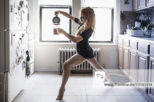 Modern dancer pouring her morning coffee