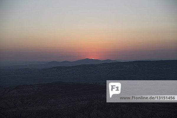 Silhouetted landscape at sunset,  Cappadocia,  Anatolia, Turkey