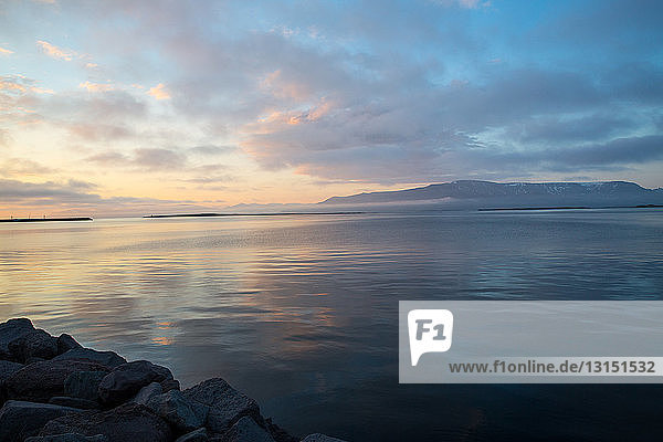 View across ocean and dramatic sky at sunset  Reykjavik  Iceland