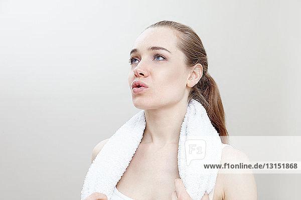 Woman wearing towel around neck Woman wearing towel around neck