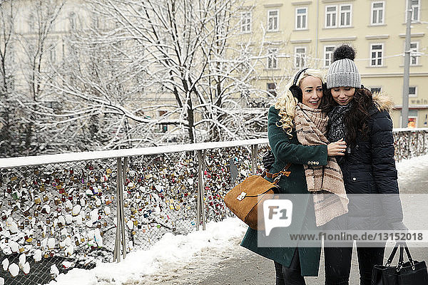 Two mid adult women wearing winter clothes
