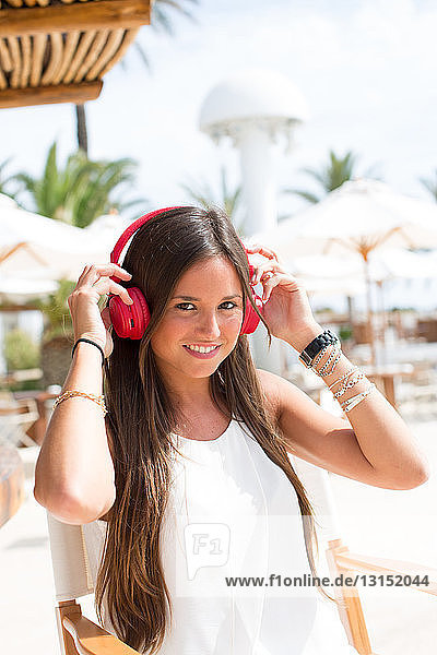 Portrait of young woman listening to headphones  Ibiza  Spain