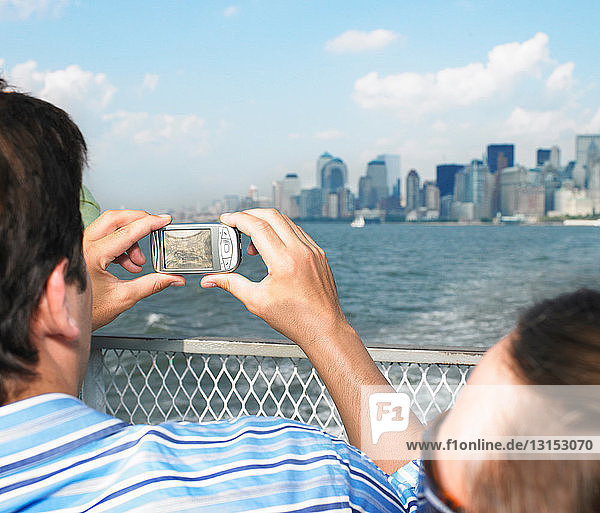 Man Taking picture of Cityscape