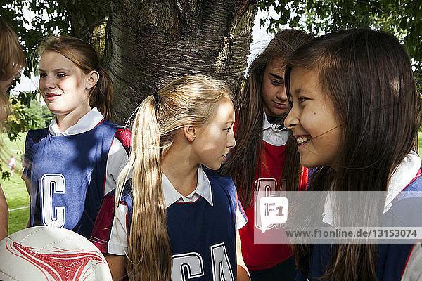 Teenage schoolgirl netball team in break