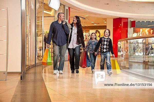 Family walking through shopping center