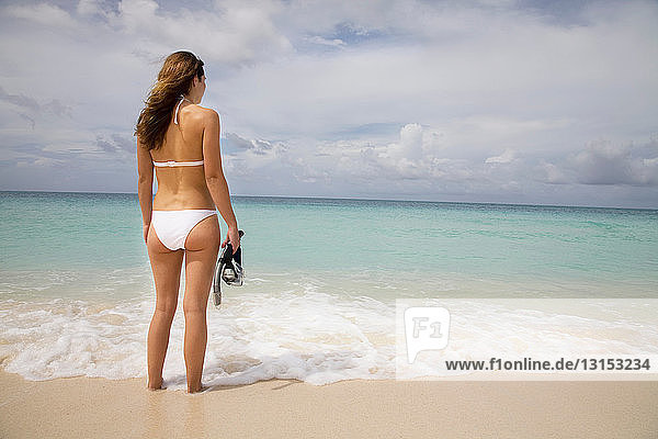 Woman on Tropical Beach With Snorkel