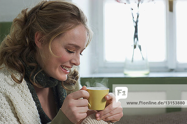 Young woman with a cup of coffee