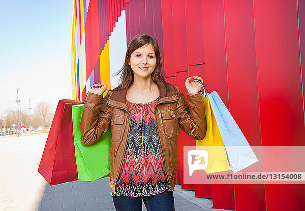 Girl with colored shopping bags