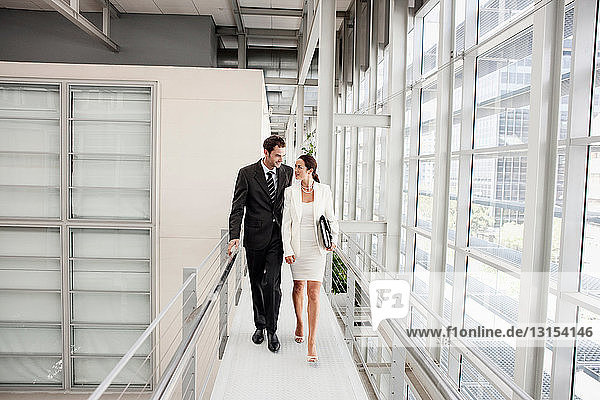 Business couple walking in corridor