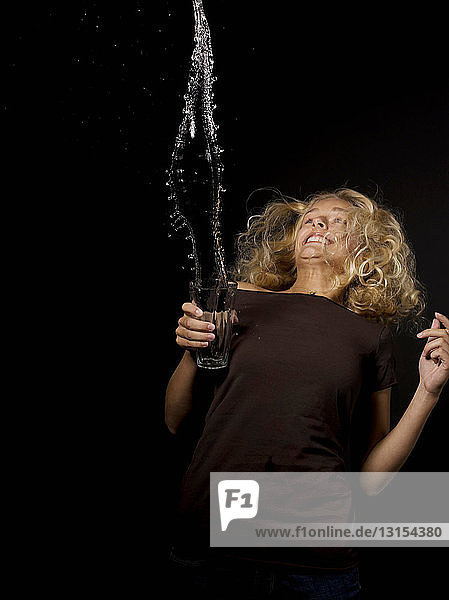 Woman throwing water from a glass