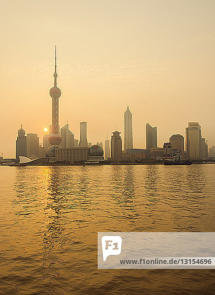 Pudong Shanghai and Yangtze river at sunset  China
